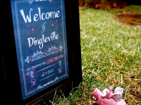 Zombie Pig arrives at the sign at the outskirts of Dingleville